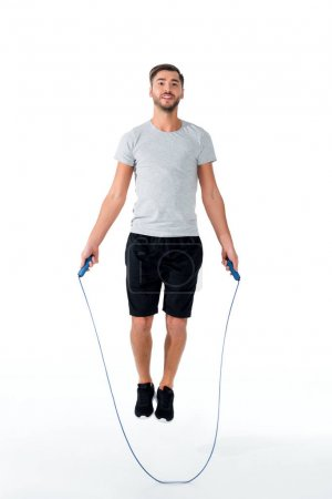 attractive sportsman with jumping rope exercising isolated on white