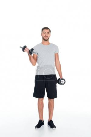 sportsman exercising with dumbbells isolated on white
