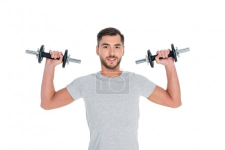 portrait of sportsman exercising with dumbbells isolated on white