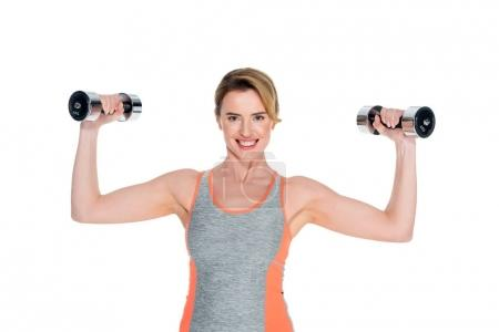 Photo for Portrait of smiling woman in sportswear exercising with dumbbells isolated on white - Royalty Free Image
