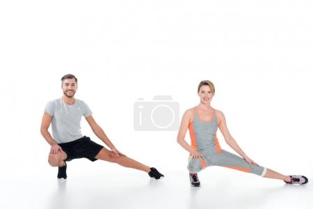 sportive couple warming up before training isolated on white