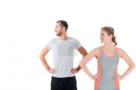 portrait of sportive couple warming up before training isolated on white