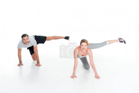 sportive couple exercising together isolated on white