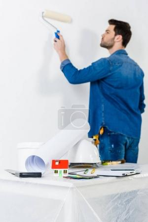 Photo for Man painting wall with paint roll brush - Royalty Free Image