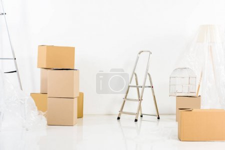 Photo for Ladders and boxes in new empty apartment - Royalty Free Image
