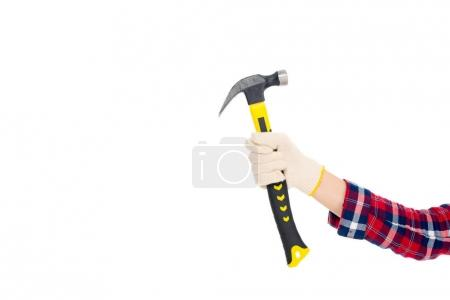 cropped view of girl in glove holding hammer, isolated on white