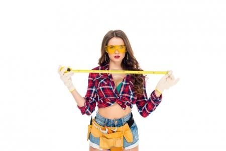 beautiful sexy girl in goggles posing with tape meaure, isolated on white