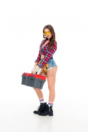 brunette girl posing with tool belt and toolbox, isolated on white