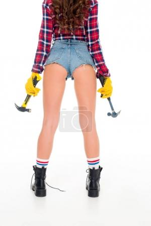 back cropped view of sexy girl with hammers, isolated on white
