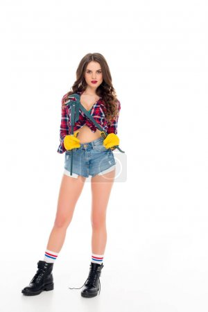 attractive sexy girl posing with adjustable wrench, isolated on white