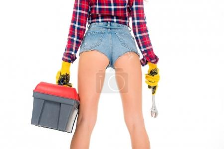 cropped view of sexy girl in gloves holding toolbox and wrench, isolated on white