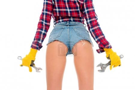 back cropped view of sexy girl with wrenches, isolated on white