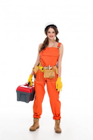 beautiful workwoman in uniform holding toolbox, isolated on white