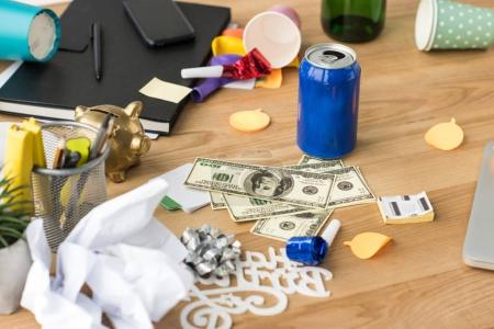 Photo for Close up view of party decorations and dollars at workplace in office - Royalty Free Image