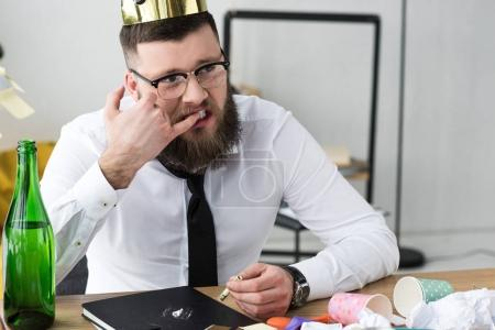 businessman taking drugs at workplace in office