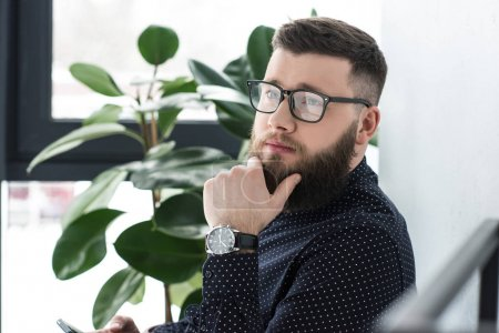Photo for Side view of pensive man in eyeglasses looking away - Royalty Free Image