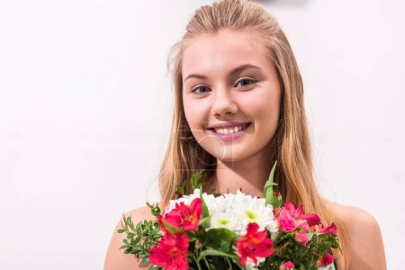 Photo for Close-up portrait of young woman with beautiful bouquet looking at camera - Royalty Free Image