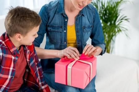 Photo for Cropped shot of mother opening gift made by her son, mothers day concept - Royalty Free Image