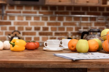 Photo for Cups with coffee and vegetables with fruits on table - Royalty Free Image