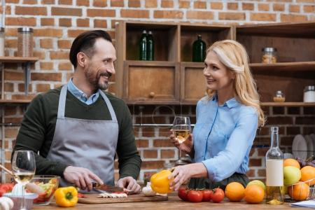 wife giving yellow bell pepper to husband