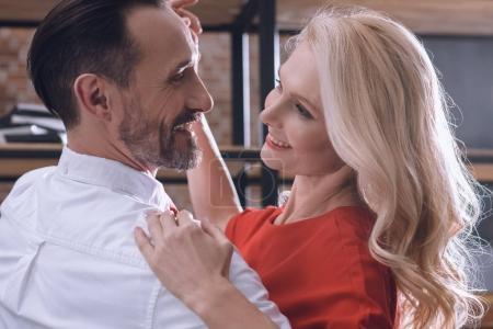smiling happy heterosexual couple dancing at home at romantic date