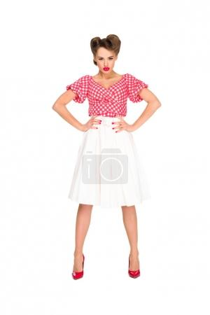 young woman in retro style clothing standing akimbo isolated on white