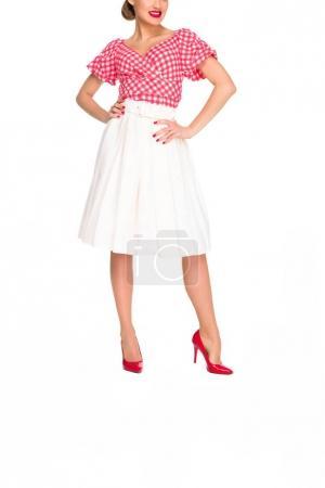 Photo pour Plan recadré de femme en talons hauts rouges et jupe isolée sur blanc - image libre de droit