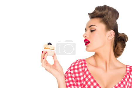 Photo for Portrait of beautiful woman in pin up clothing with cupcake isolated on white - Royalty Free Image