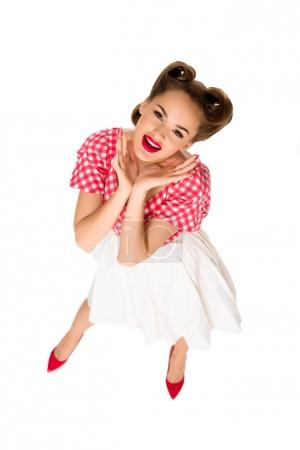 overhead view of attractive young woman in retro clothing isolated on white