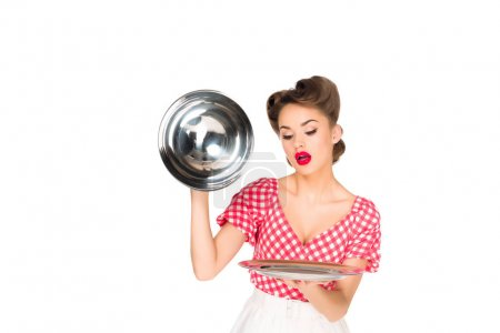 portrait of beautiful young woman in retro clothing with empty serving tray in hands isolated on white