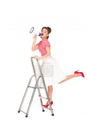 pin up woman with loudspeaker standing on ladder isolated on white