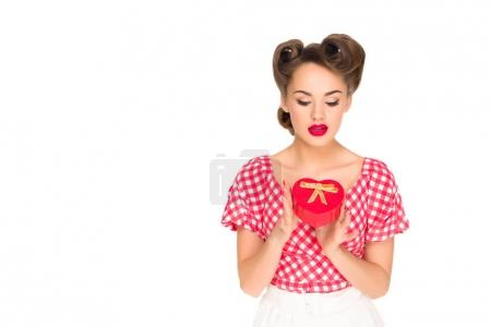 portrait of stylish woman in retro clothing with heart shaped gift isolated on white