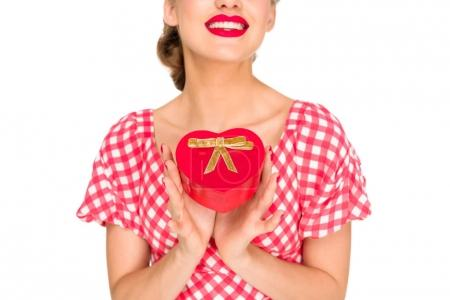 partial view of stylish woman in retro clothing with heart shaped gift isolated on white