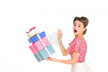 side view of beautiful woman in retro clothing holding falling wrapped presents isolated on white