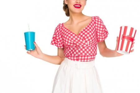 partial view of woman in retro style clothing with pop corn and drink in hands isolated on white
