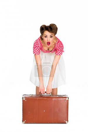 emotional beautiful young woman in retro clothing holding suitcase isolated on white
