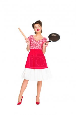 stylish woman in retro clothing with rolling pin and frying pan isolated on white