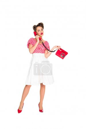 pin up woman talking on old telephone isolated on white