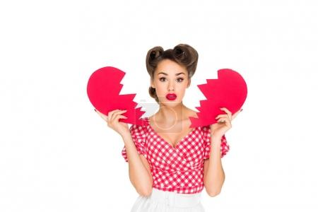 portrait of beautiful young woman in retro clothing with ripped paper heart isolated on white