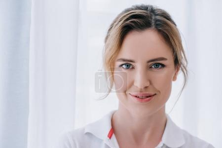 Photo for Close-up portrait of attractive adult woman smiling at camera - Royalty Free Image