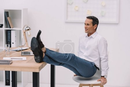 strong and healthy businessman standing on hands in seat at office