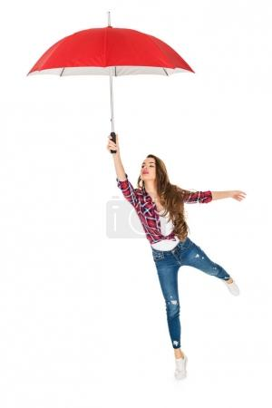 beautiful young woman holding red umbrella isolated on white