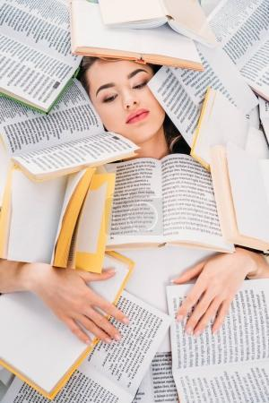 beautiful girl with books above, education and reading concept