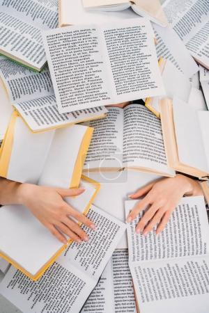 female hands and books, reading and education concept