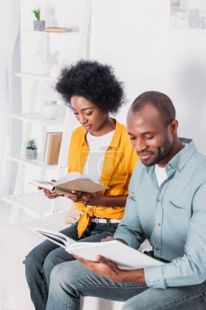 african american couple reading books at home