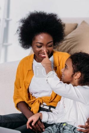 african american mother and daughter having fun at home