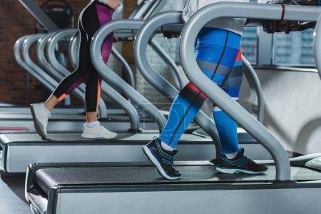 low section of women training on treadmills