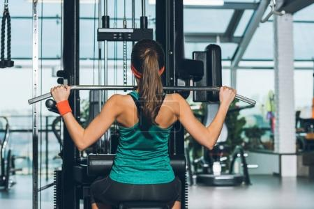 sporty woman working out on training apparatus