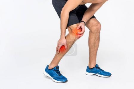 cropped shot of man with pain in leg on white