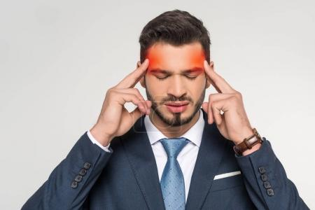 stylish young businessman suffering from headache isolated on grey